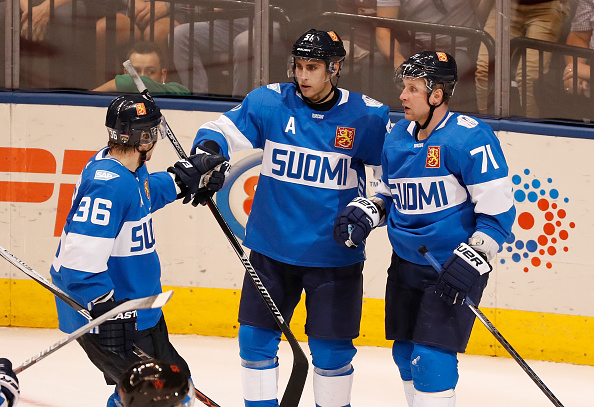 TORONTO, ON - SEPTEMBER 18: Valtteri Filppula #51 of Team Finland celebrates his third period goal with Jussi Jokinen #36 and Leo Komarov #71 while playing Team North America during the World Cup of Hockey at the Air Canada Center on September 18, 2016 in Toronto, Canada. Team North America won the game 4-1. (Photo by Gregory Shamus/Getty Images)