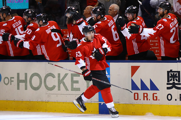 TORONTO, ON - SEPTEMBER 24:  Brad Marchand #63 of Team Canada is congratulated by his teammates after after scoring a third period goal against Team Russia at the semifinal game during the World Cup of Hockey tournament at Air Canada Centre on September 24, 2016 in Toronto, Canada.  (Photo by Bruce Bennett/Getty Images)