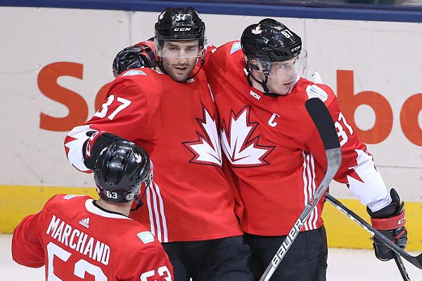 TORONTO, ON - SEPTEMBER 21: Sidney Crosby #87 of Team Canada celebrates his first period goal with Patrice Bergeron #37 and Brad Marchand #63 against Team Europe during the World Cup of Hockey tournament at the Air Canada Centre on September 21, 2016 in Toronto, Canada. (Photo by Tom Szczerbowski/Getty Images) *** Local Caption *** Sidney Crosby;Patrice Bergeron;Brad Marchand