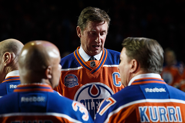 EDMONTON, AB - APRIL 6:  Former Oiler Wayne Gretzky chats with fellow alumni Grant Fuhr and Jari Kurri during the closing ceremonies at Rexall Place following the game between the Edmonton Oilers and the Vancouver Canucks on April 6, 2016 at Rexall Place in Edmonton, Alberta, Canada. The game was the final game the Oilers played at Rexall Place before moving to Rogers Place next season. (Photo by Codie McLachlan/Getty Images)