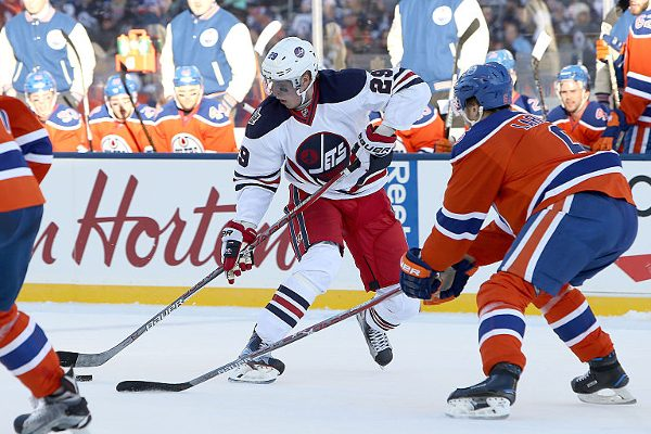 WINNIPEG, MANITOBA - OCTOBER 23: Patrik Laine #29 of the Winnipeg Jets works to get past Adam Larsson #6 of the Edmonton Oilers during the 2016 Tim Hortons NHL Heritage Classic hockey game on October 23, 2016 at Investors Group Field in Winnipeg, Manitoba, Canada. (Photo by Jason Halstead /Getty Images) *** Local Caption *** Patrik Lain; Adam Larsson