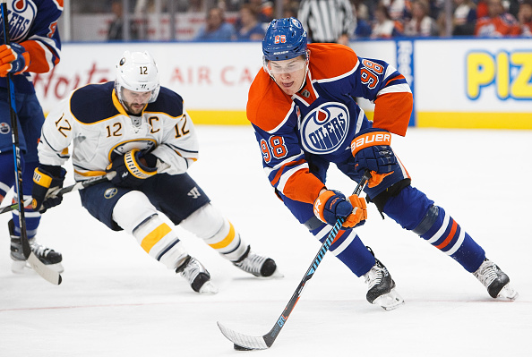EDMONTON, AB - OCTOBER 16:  Jesse Puljujarvi #98 of the Edmonton Oilers is pursued by Brian Gionta #12 of the Buffalo Sabres on October 16, 2016 at Rogers Place in Edmonton, Alberta, Canada. (Photo by Codie McLachlan/Getty Images)