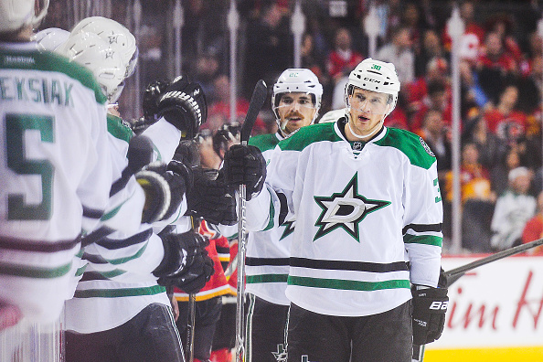 CALGARY, AB - NOVEMBER 10: Lauri Korpikoski #38 (C) of the Dallas Stars celebrates with his teammates after scoring against the Calgary Flames during an NHL game at Scotiabank Saddledome on November 10, 2016 in Calgary, Alberta, Canada. (Photo by Derek Leung/Getty Images)