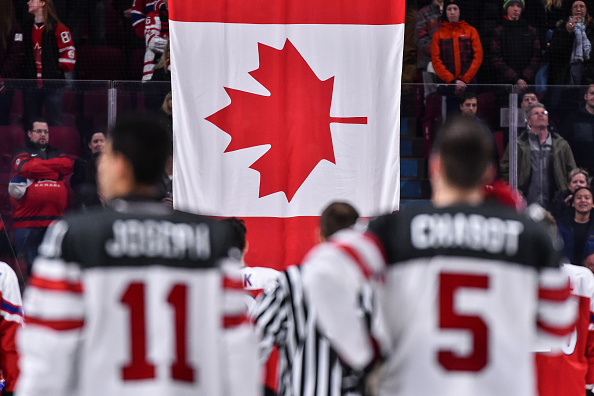 MONTREAL, QC - JANUARY 02:  The Canadian flag is raised after Team Canada's victory over Team Czech Republic during the 2017 IIHF World Junior Championship quarterfinal game at the Bell Centre on January 2, 2017 in Montreal, Quebec, Canada.  Team Canada defeated Team Czech Republic 5-3.  (Photo by Minas Panagiotakis/Getty Images)